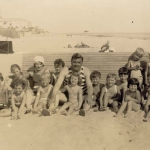 Babe Ruth and Claire on the Beach With Kids