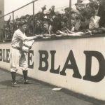Babe Ruth Signing Autographs in the Bleachers