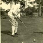 Babe Ruth making a putt