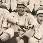 Babe Ruth posing with the Red Sox Team