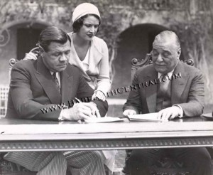 Babe Ruth Signing Contract with Colonel Ruppert with Babe's wife Claire Looking On