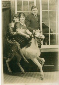 Babe Ruth posing, while first wife Helen and Edna Bancroft on Carousel Horse