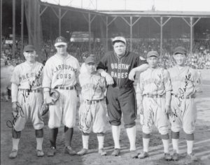 Babe Ruth Lou Gehrig and Japanese AllStars. Kenichi Zenimura is in between Lou and Babe.